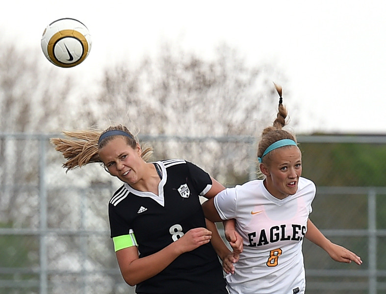 Thompson Valley's #6 Kaili Campbell Berthoud's #8Savannah Hepworth go up for a header during their game Monday, April 24, 2017, at Mountain View High School in Loveland.  (Photo by Jenny Sparks/Loveland Reporter-Herald)