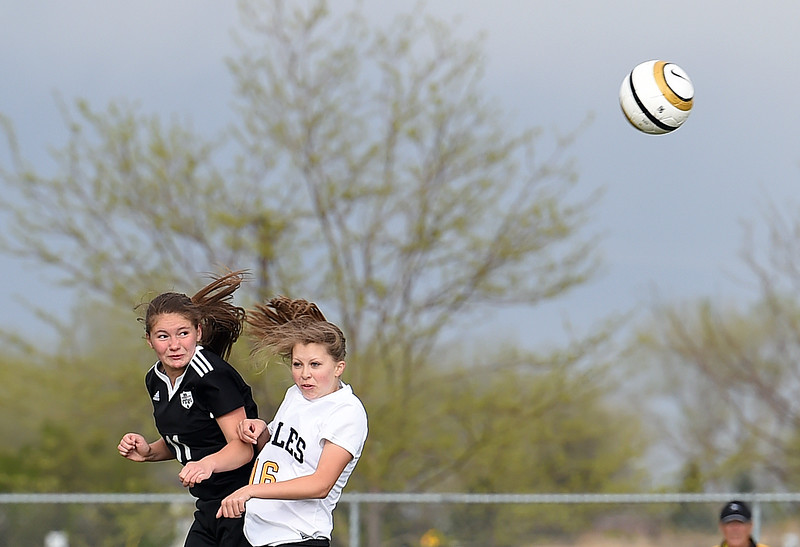 Thompson Valley's #16 Samantha Bryson and Berthoud's #11 Lily Degnan go up for a header during their game Monday, April 24, 2017, at Mountain View High School in Loveland.  (Photo by Jenny Sparks/Loveland Reporter-Herald)