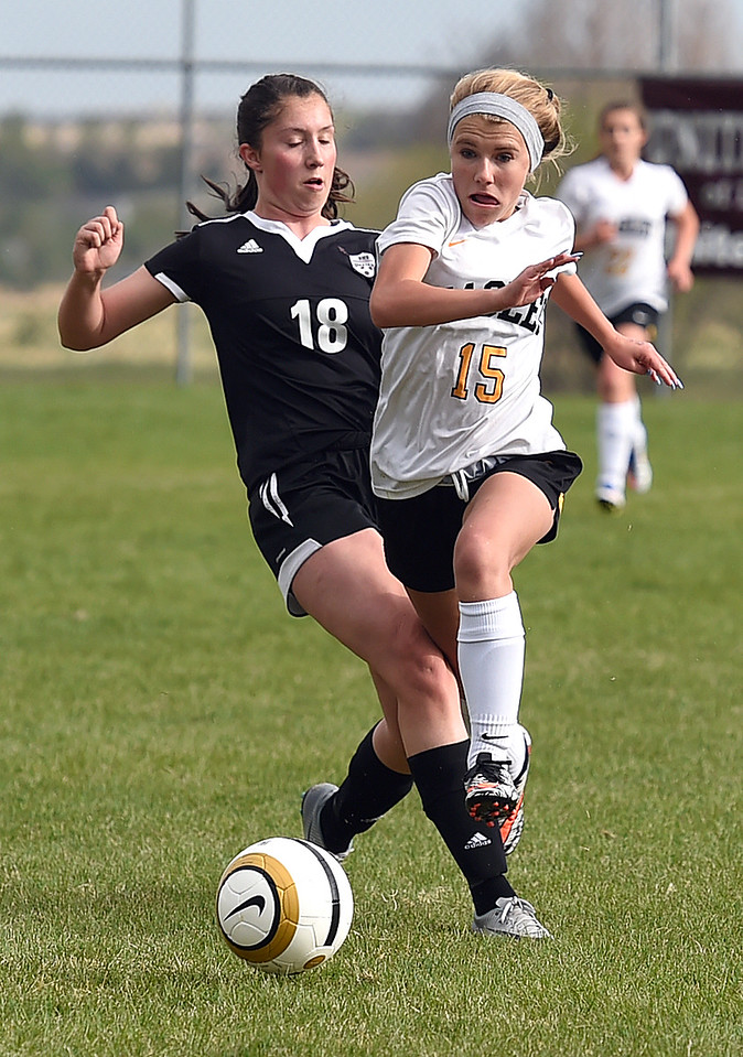 Thompson Valley's #15 Gracy Roitsch and Berthoud's #18 Fallon Stockley go for the ball during their game Monday, April 24, 2017, at Mountain View High School in Loveland.  (Photo by Jenny Sparks/Loveland Reporter-Herald)