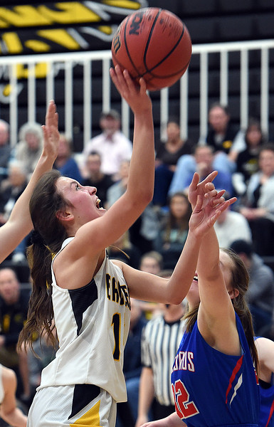 Thompson Valley's Emily Black goes up for a shot as Centaurus' Sophia Vaillareal tries to block during their game on Friday, Feb. 15, 2019, at Thompson Valley High School in Loveland.  (Photo by Jenny Sparks/Loveland Reporter-Herald)