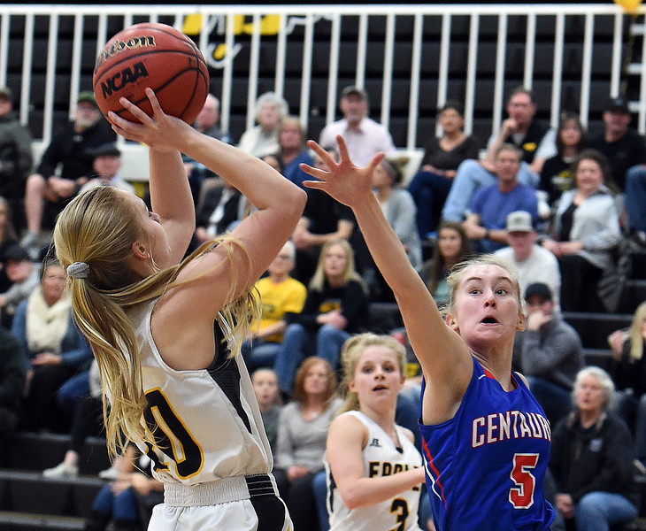 Thompson Valley's Sam McCrimmon goes up for a shot as Centaurus' Julia Mischke tries to block during their game on Friday, Feb. 15, 2019, at Thompson Valley High School in Loveland.  (Photo by Jenny Sparks/Loveland Reporter-Herald)