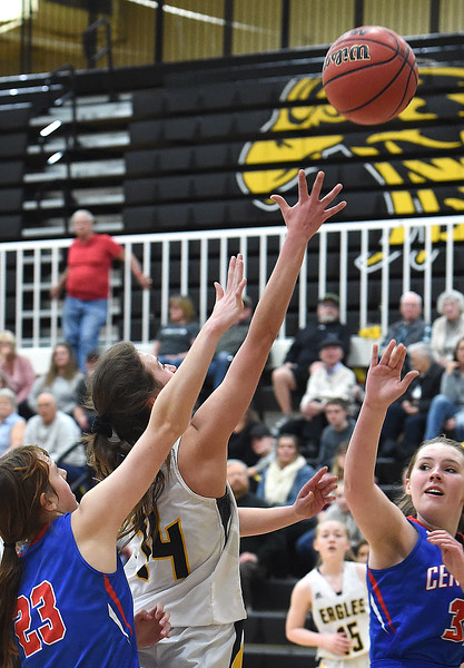 Thompson Valley's Kylie Bowen goes up for a shot as Centaurus' Natalie Kramer tries to block during their game on Friday, Feb. 15, 2019, at Thompson Valley High School in Loveland.  (Photo by Jenny Sparks/Loveland Reporter-Herald)