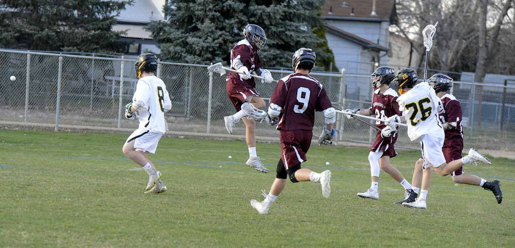 . Greg Bilek of Thompson Valley rifles a shot through the Cheyenne Mountain defense for a goal Monday night at Patterson Stadium. The Eagles won the top-five matchup in 4A, 13-12. (Mike Brohard/Loveland Reporter-Herald).