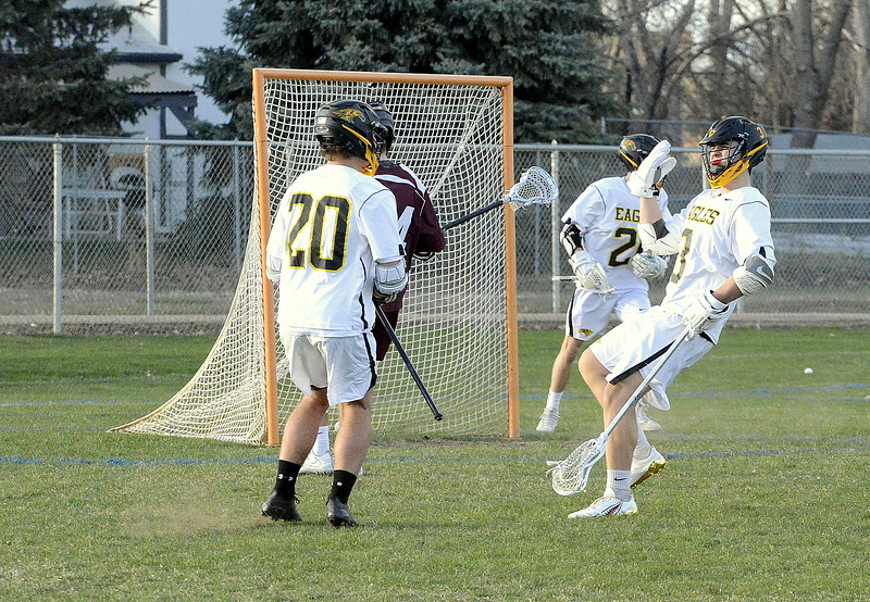 Thompson Valley's Colby Mauck celebrates a first-quarter goal with teammate Caleb Smith during Monday's game with Cheyenne Mountain at Patterson Stadium. The Eagles won 13-12. (Mike Brohard/Loveland Reporter-Herald).