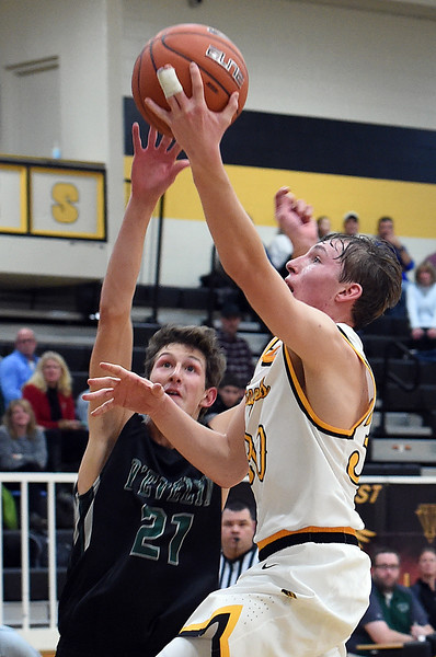 Thompson Valley's #30 Mitch Zundel goes up for a shot as D'Evelyn's #21 C.J. Olson tries to block during their game Tuesday, Dec. 14, 2016, at Thompson Valley High School in Loveland. (Photo by Jenny Sparks/Loveland Reporter-Herald)