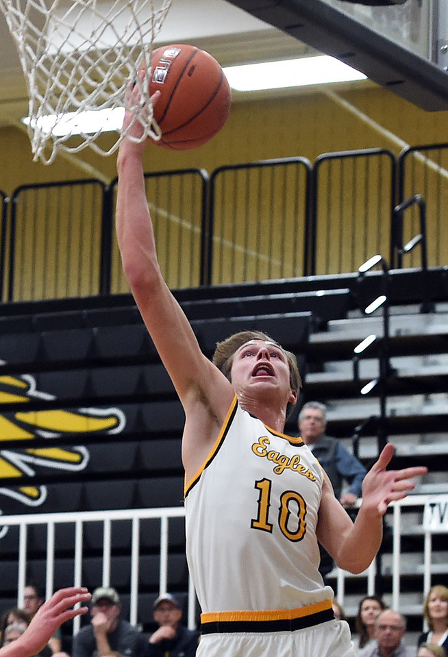 Thompson Valley's #10 Justin Wiersema goes up for a shot during their game against D'Evelyn's game Tuesday, Dec. 14, 2016, at Thompson Valley High School in Loveland. (Photo by Jenny Sparks/Loveland Reporter-Herald)
