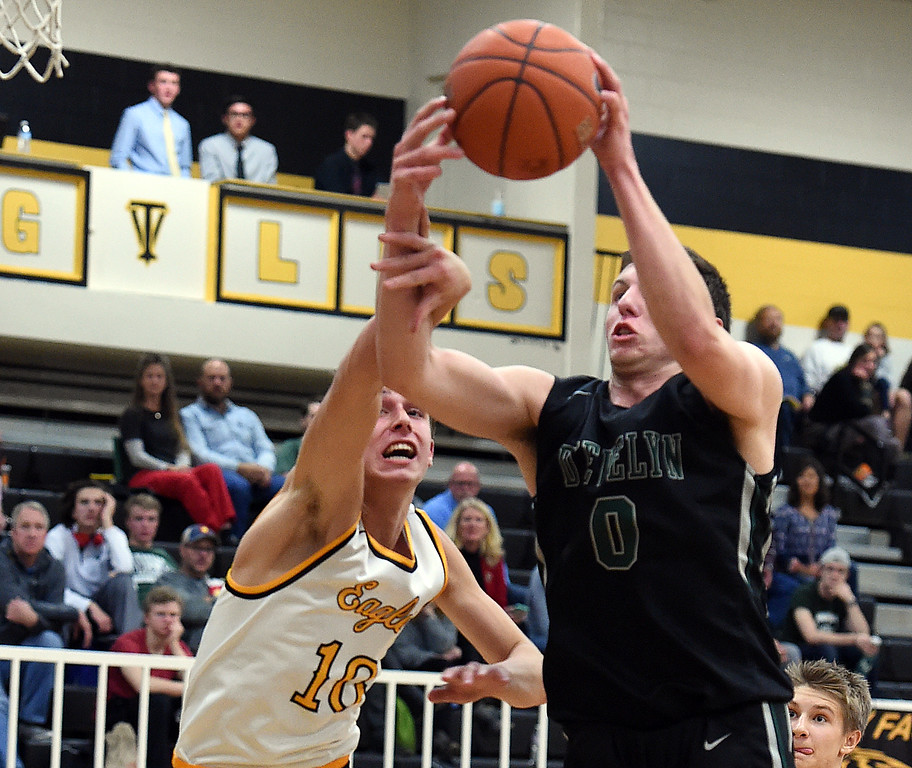 Thompson Valley's #10 Justin Wiersema and D'Evelyn's #0 Charles Dinegar go up for a rebound during their game Tuesday, Dec. 14, 2016, at Thompson Valley High School in Loveland. (Photo by Jenny Sparks/Loveland Reporter-Herald)