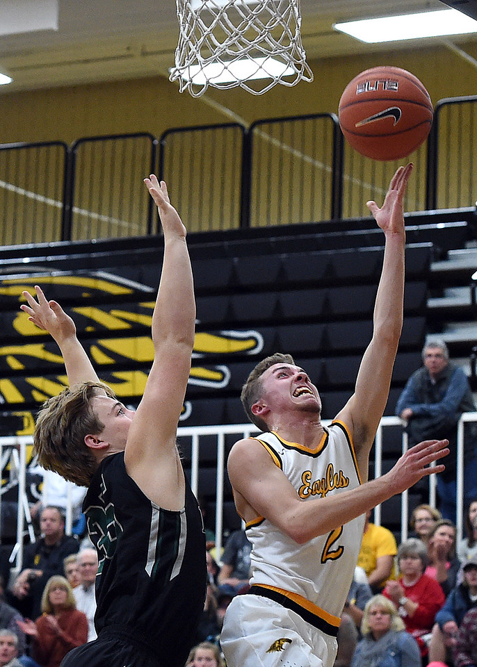 Thompson Valley's #2 Jeremy Wagonmaker goes up for a shot as D'Evelyn's #35 Nolan Balbin tries to block during their game Tuesday, Dec. 14, 2016, at Thompson Valley High School in Loveland. (Photo by Jenny Sparks/Loveland Reporter-Herald)