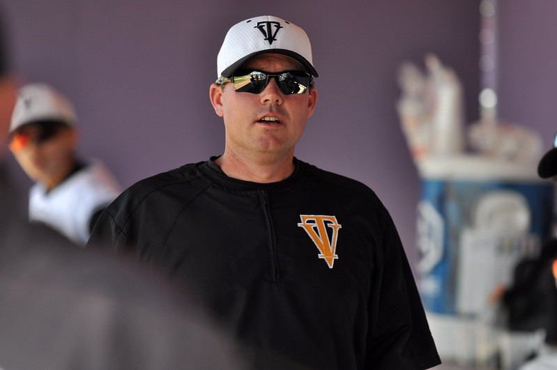 Thompson Valley coach Jay Denning rallies his players in the dugout Saturday at Denver North High School. (Cris Tiller / Loveland Reporter-Herald)
