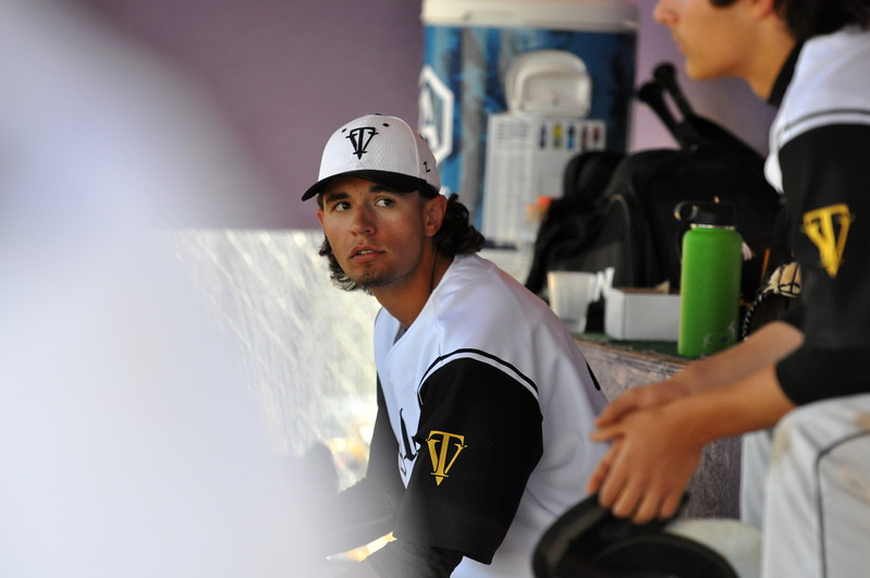 Thompson Valley's Bailey Porter rests in the dugout between innings Saturday at Denver North High School. (Cris Tiller / Loveland Reporter-Herald)