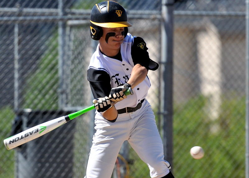 Thompson Valley's Tristan Schatz eye a pitch Saturday at Denver North High School. (Cris Tiller / Loveland Reporter-Herald)