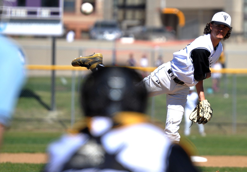Thompson Valley's Bailey Porter delivers a strike Saturday at Denver North High School. (Cris Tiller / Loveland Reporter-Herald)