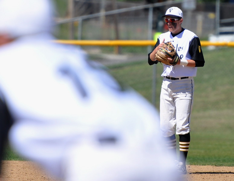Thompson Valley shortstop Austin Sobraske prepares before a pitch Saturday at Denver North High School. (Cris Tiller / Loveland Reporter-Herald)
