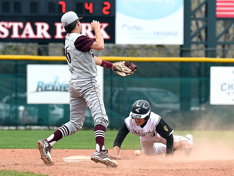 Thompson Valley's (3) Brandon Lobue gets back to third as Golden's (6) Ben McLaughlin misses the ball Monday, May 22, 2017, during their state playoff baseball game at All Star Stadium in Lakewood.  (Photo by Jenny Sparks/Loveland Reporter-Herald)
