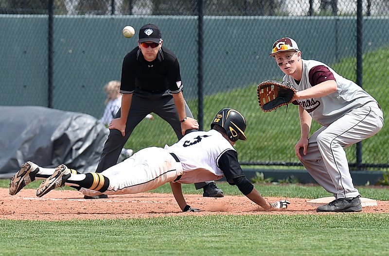 Thompson Valley's (5) Tristan Schatz tries to get back to first as Golden's (17) Matt Kneeskern keeps his eye on the ball Monday, May 22, 2017, during their state playoff baseball game at All Star Stadium in Lakewood.  (Photo by Jenny Sparks/Loveland Reporter-Herald)