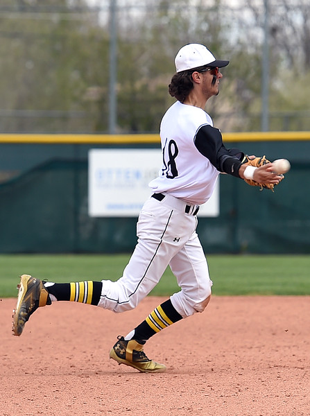 Thompson Valley's (18) Bailey Porter throws the ball to first Monday, May 22, 2017, during their state playoff baseball game against Golden High School at All Star Stadium in Lakewood.  (Photo by Jenny Sparks/Loveland Reporter-Herald)