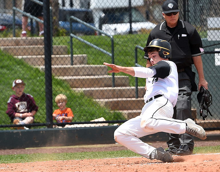 Thompson Valley's (11) Mike Berg slides in to home to score their first point  Monday, May 22, 2017, during their state playoff baseball game against Golden High School at All Star Stadium in Lakewood.  (Photo by Jenny Sparks/Loveland Reporter-Herald)