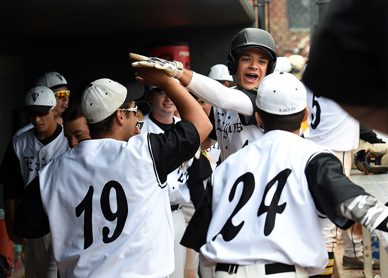 Teammates help Thompson Valley's (4) Cameron Nellor celebrate his go ahead RBI double in the 8th inning Monday, May 22, 2017, during their state playoff baseball game against Golden High School at All Star Stadium in Lakewood.  (Photo by Jenny Sparks/Loveland Reporter-Herald)