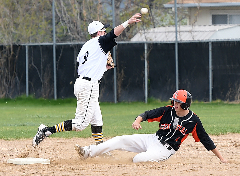 Thompson Valley's #8 Austin Sobraske throws the ball to first after tagging out Greeley Central's #1 Sage Hudson during their game Wednesday, April 26, 2017, at Constantz Field in Loveland. (Photo by Jenny Sparks/Loveland Reporter-Herald)<br /> tv8 s1