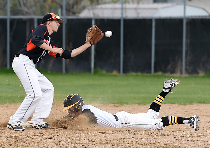 Thompson Valley's #Austin Sobraske slides in to second base as Greeley Central's #Sage Hudson catches the ball during their game Wednesday, April 26, 2017, at Constantz Field in Loveland. (Photo by Jenny Sparks/Loveland Reporter-Herald)<br /> tv8 gc1