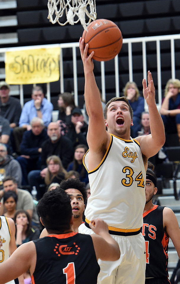 Thompson Valley's (34) Joey Shaffer goes up for a shot past Greeley Central's (1) Steven Maldonado during their game Monday, Feb, 12, 2018, at Thompson Valley in Loveland. (Photo by Jenny Sparks/Loveland Reporter-Herald)