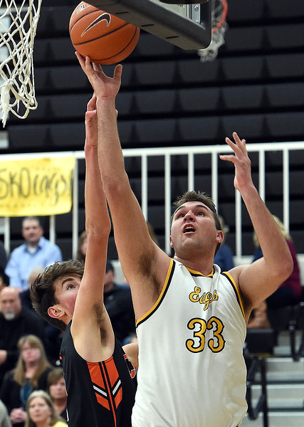 Thompson Valley's (33) Jared Kasprzak goes up for a shot past Greeley Central's Marcos Hernandez during their game Monday, Feb, 12, 2018, at Thompson Valley in Loveland. (Photo by Jenny Sparks/Loveland Reporter-Herald)