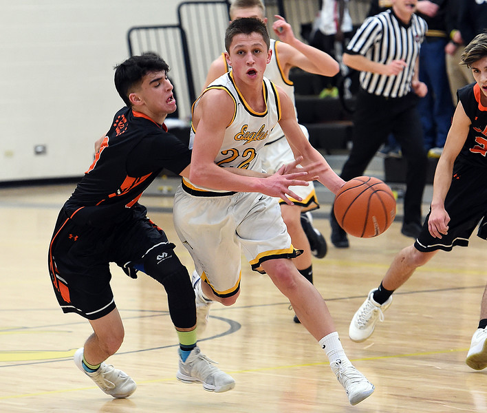 Thompson Valley's (22) Hayden Ell drives the ball down court past Greeley Central's (0) Spencer Conway during their game Monday, Feb, 12, 2018, at Thompson Valley in Loveland. (Photo by Jenny Sparks/Loveland Reporter-Herald)