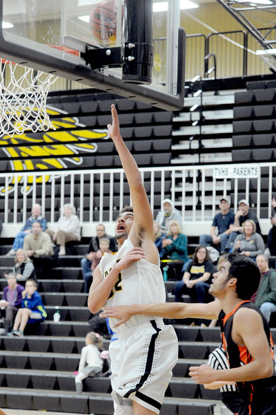 Jacob Bosse (32), of Thompson Valley, makes a layup during the first half against Greeley Central, Tuesday Jan. 26, 2016 in Loveland. (Photo by Trevor Davis/Loveland Reporter-Herald)