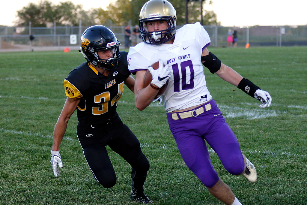 . Thompson Valley�s Wolfgang Warner (34) goes in to tackle Holy Family�s Braedon Peters (10) on Thurdsay, Sept. 21, 2017 at Patterson field. (Photo by Lauren Cordova/Loveland Reporter-Herland)