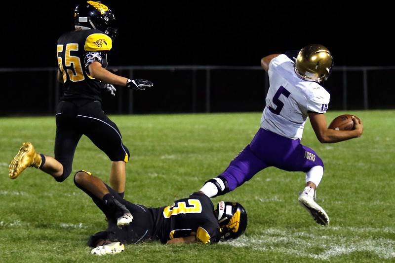 Thompson Valley's Tyson Bochert (3) tackles Holy Family's Stone Samaras (5) at the 40 yard line on Thurdsay, Sept. 21, 2017 at Patterson field. (Photo by Lauren Cordova/Loveland Reporter-Herland)