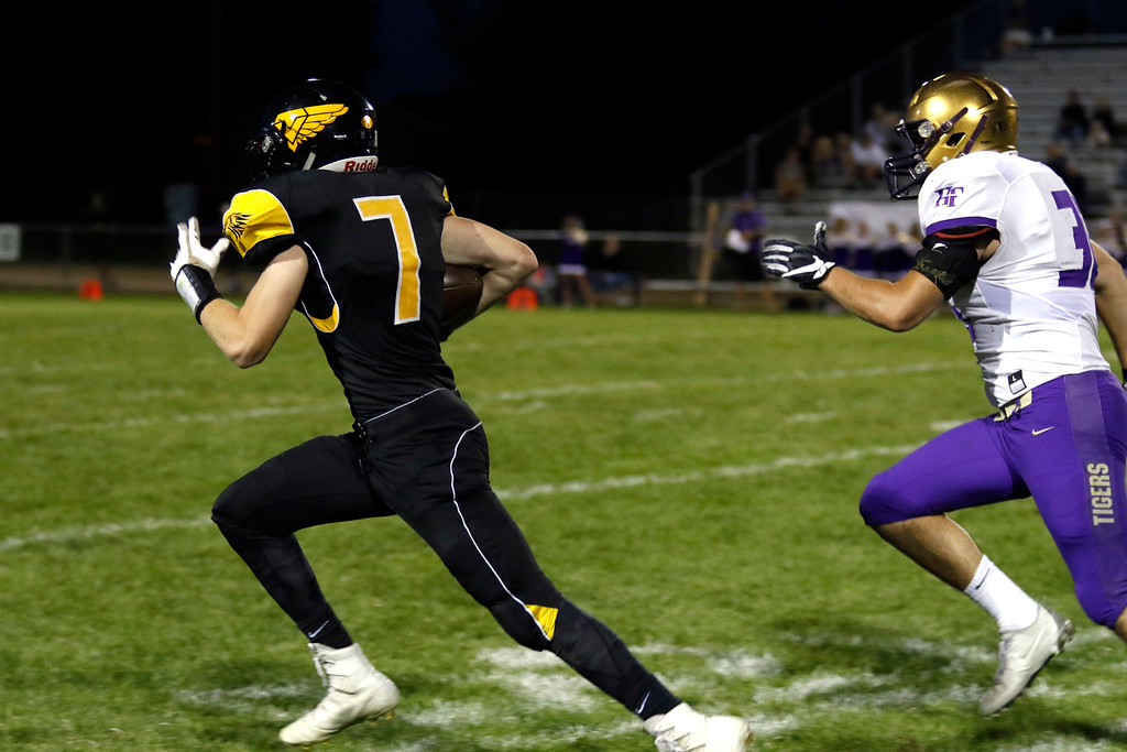 . Thompson Valley�s Jack Dyken (7) runs the ball toward the goal line on Thurdsay, Sept. 21, 2017 at Patterson field. (Photo by Lauren Cordova/Loveland Reporter-Herland)