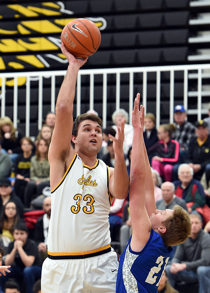 Thompson Valley's (33) Jared Kasprzak goes up for a shot past Longmont's (21) Dallas Dye during their game Tuesday, Jan. 23, 2018, at Thompson Valley High School in Loveland.  (Photo by Jenny Sparks/Loveland Reporter-Herald)
