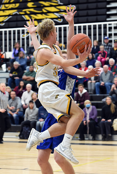 Thompson Valley's (30) Andrew Wiersema goes up for a shot past Longmont's (32) Beck Page during their game Tuesday, Jan. 23, 2018, at Thompson Valley High School in Loveland.  (Photo by Jenny Sparks/Loveland Reporter-Herald)