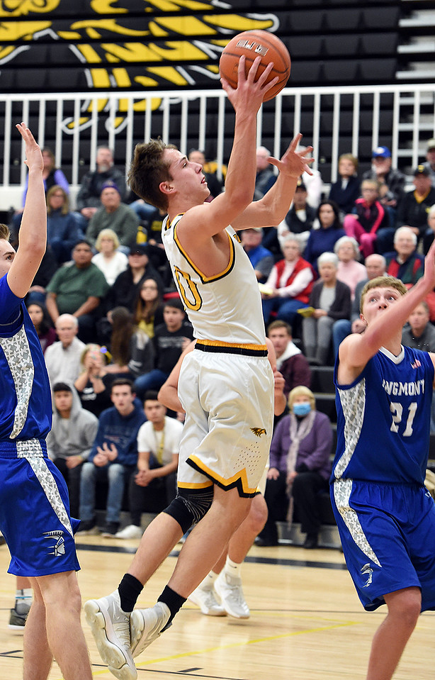Thompson Valley's (10) Justin Wiersema goes up for a shot past Longmont's (21) Dallas Dye during their game Tuesday, Jan. 23, 2018, at Thompson Valley High School in Loveland.  (Photo by Jenny Sparks/Loveland Reporter-Herald)