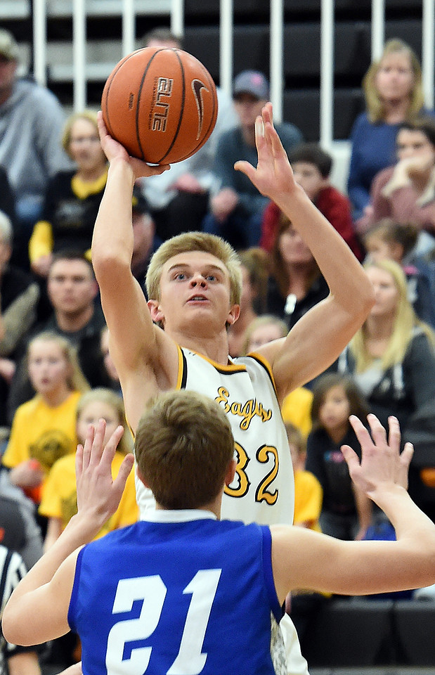 Thompson Valley's (32) Darren Edwards goes up for a shot past Longmont's (21) Dallas Dye during their game Tuesday, Jan. 23, 2018, at Thompson Valley High School in Loveland.  (Photo by Jenny Sparks/Loveland Reporter-Herald)