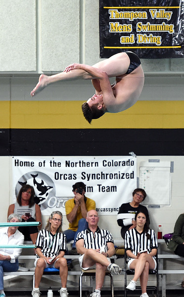 Thompson Valley's Brandon Bicknell performs a dive Thursday, April 20, 2017, during their meet against Longmont High School at Thompson Valley in Loveland. (Photo by Jenny Sparks/Loveland Reporter-Herald)
