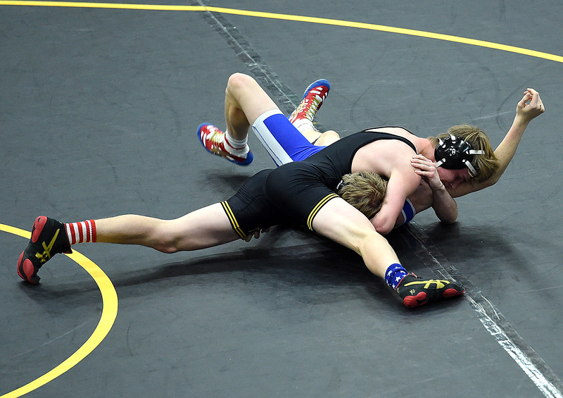 Thompson Valley's Trent Suppus wrestles Longmont's Leif Nuesnen during their 138-pound match Thursday, Jan. 4, 2017, at Thompson Valley High School in Loveland. Suppus won the match.   (Photo by Jenny Sparks/Loveland Reporter-Herald)