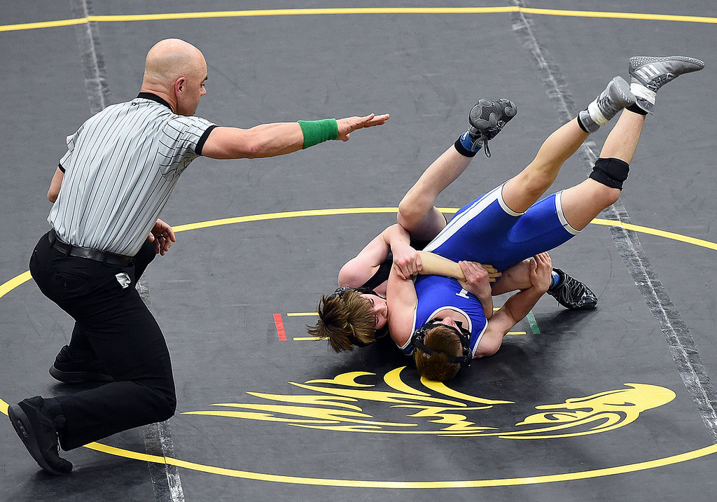 . Thompson Valley\'s Jacob Bierman wrestles Longmont\'s Gabe Sedios during their 113-pound match Thursday, Jan. 4, 2017, at Thompson Valley High School in Loveland. Bierman won the match.   (Photo by Jenny Sparks/Loveland Reporter-Herald)