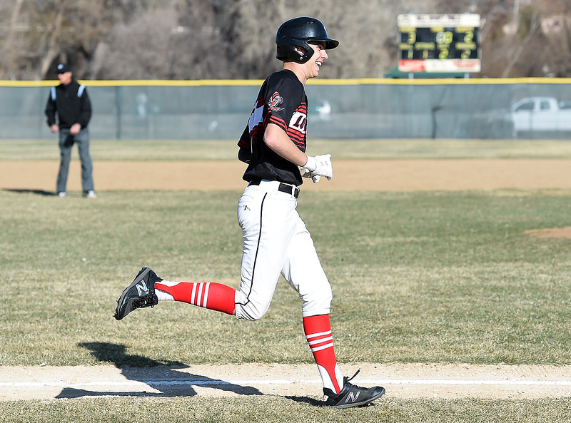 Loveland's (7) Zach Harstad is all smiles as he rounds the bases after hitting a homerun during their game against Thompson Valley Tuesday, March 27, 2018, at Swift Field in Loveland.  (Photo by Jenny Sparks/Loveland Reporter-Herald)