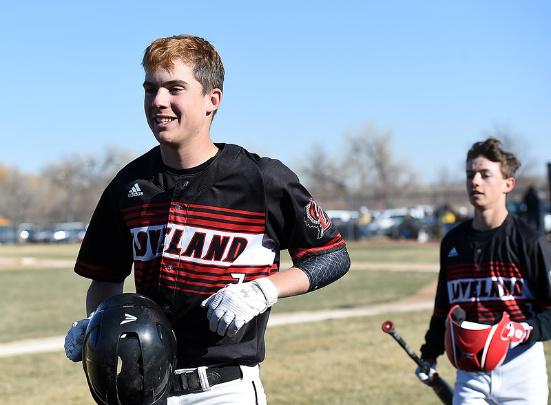 Loveland's Zach Harstad, front, is all smiles as he heads to the dugout against Thompson Valley Tuesday, March 27, 2018, at Swift Field in Loveland.  (Photo by Jenny Sparks/Loveland Reporter-Herald)