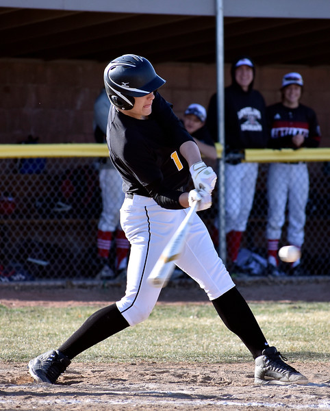 Thompson Valley's (1) Brock Nellor successfully gets a hit on the ball during their game against Loveland High School on Tuesday, March 27, 2018 at Centennial Baseball Complex in Loveland. Photo by Thieng Mai/Loveland Reporter-Herald.