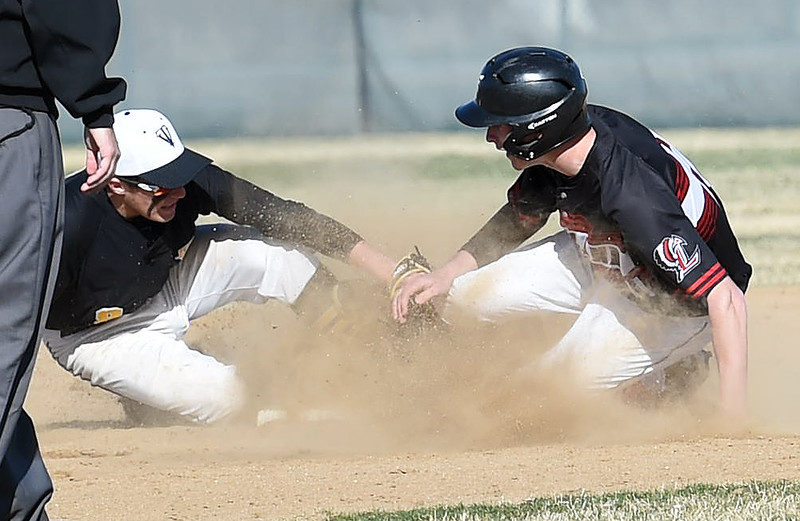 Thompson Valley's (8) Austin Sobraske tries to tag Loveland's (11) Matt Weichel as he slides into second during their game against Tuesday, March 27, 2018, at Swift Field in Loveland.  (Photo by Jenny Sparks/Loveland Reporter-Herald)