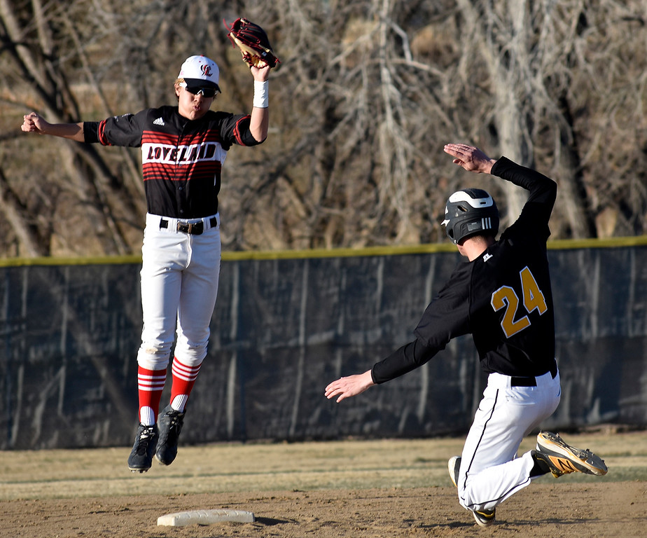 Thompson Valley's (24) Trey Kreikemeir attempts to slide into second base as Loveland's (1) Jaxon Cabrera catches the ball to tag him out during their game on Tuesday, March 27, 2018 at Centennial Baseball Complex in Loveland. Photo by Thieng Mai/Loveland Reporter-Herald.