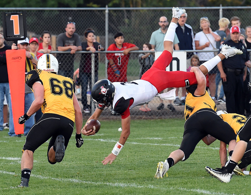 . Loveland\'s (2) Riley Kinney reaches for the endzone as Thompson Valley\'s (61) Caleb Burton tries to stop him during ther game Friday, Sept. 7, 2018, at Patterson Stadium in Loveland.  (Photo by Jenny Sparks/Loveland Reporter-Herald)