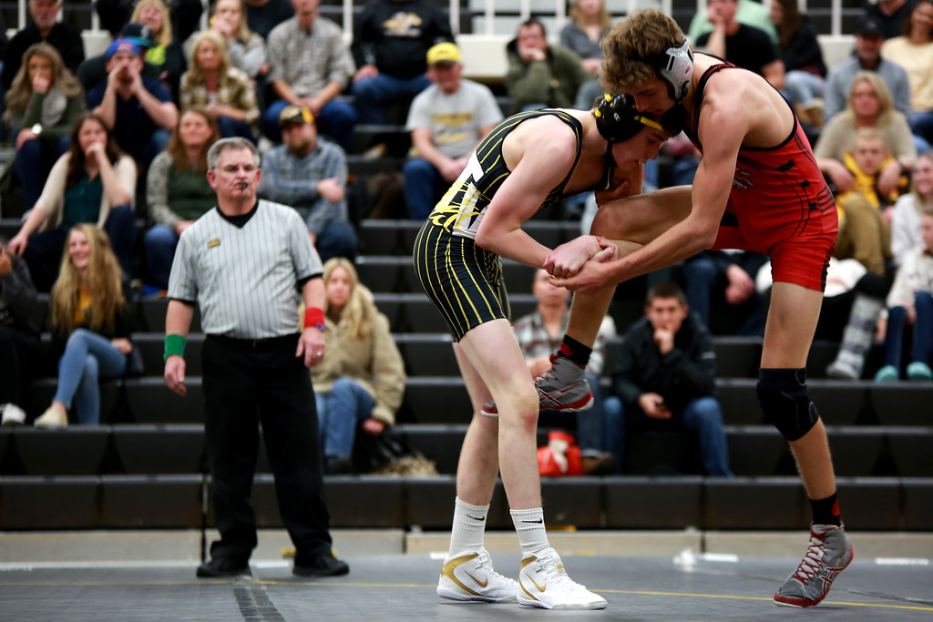 . Thompson Valley�s Justin McLaughlin and Loveland�s Jude Quinlan face off in the 132 weight class during Friday night�s wrestling match on Dec. 7, 2018 at Thompson Valley High School in Loveland, Colo.Photo by Taelyn Livingston/ Loveland Reporter-Herald