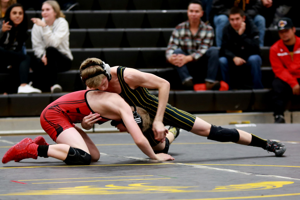 . Thompson Valley�s Logan McCrimmon and Loveland�s Kobi Johnson face off in the 106 weight class during Friday night�s wrestling match on Dec. 7, 2018 at Thompson Valley High School in Loveland, Colo.Photo by Taelyn Livingston/ Loveland Reporter-Herald