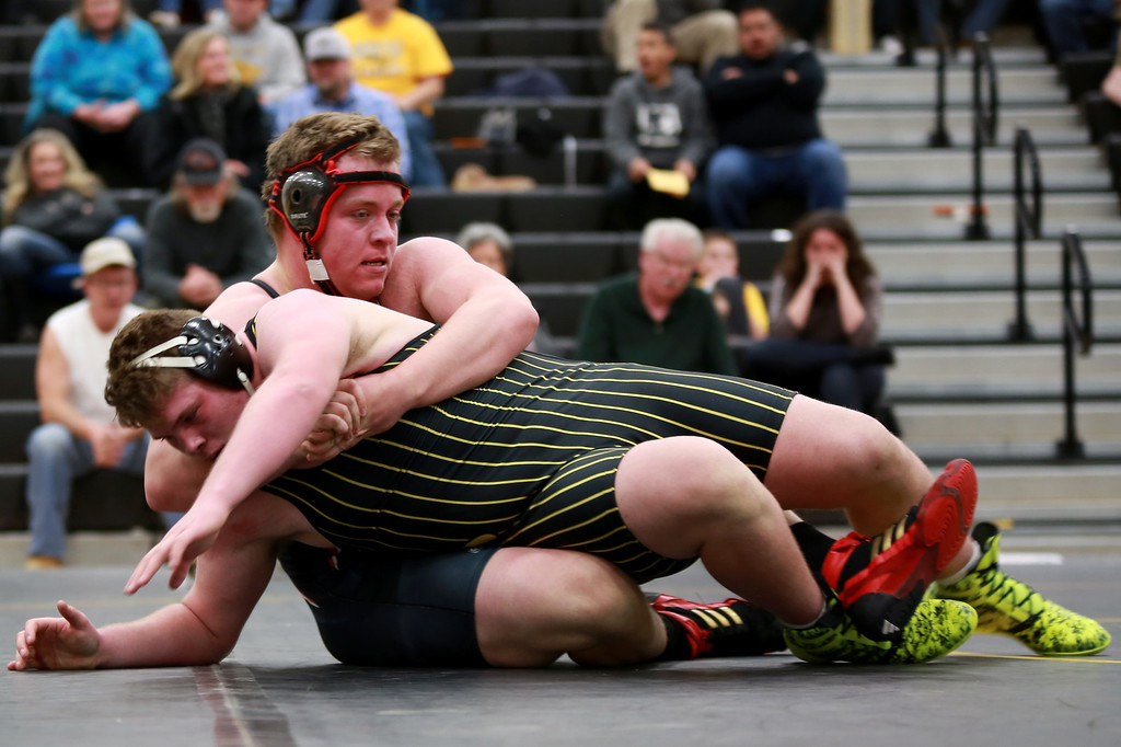 . Loveland�s Cameron Nolin and Thompson Valley�s Sage Gavin face eachother in the 285 weight class during Friday night�s wrestling match on Dec. 7, 2018 at Thompson Valley High School in Loveland, Colo.Photo by Taelyn Livingston/ Loveland Reporter-Herald