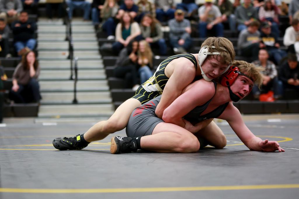 . Thompson Valley�s Gage Juergensen and Loveland�s Cody Weimer face off in their 152 weight class during Friday night�s wrestling match on Dec. 7, 2018 at Thompson Valley High School in Loveland, Colo.Photo by Taelyn Livingston/ Loveland Reporter-Herald