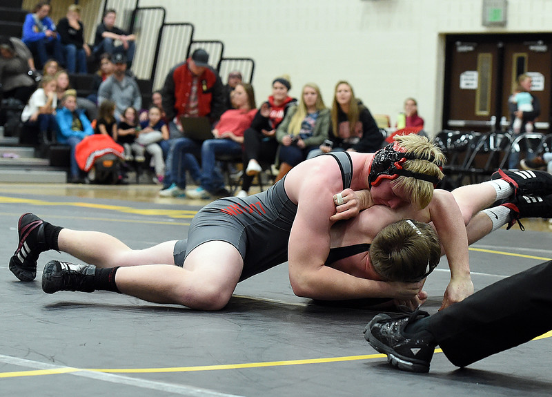 Loveland's Michael Teesdale wrestles Thompson Valley's Chris Ringus Airiel Siegel during their 220-pound match Friday, Dec. 9, 2016, at Thompson Valley High School in Loveland. Teesdale won the match.  (Photo by Jenny Sparks/Loveland Repdorter-Herald)220