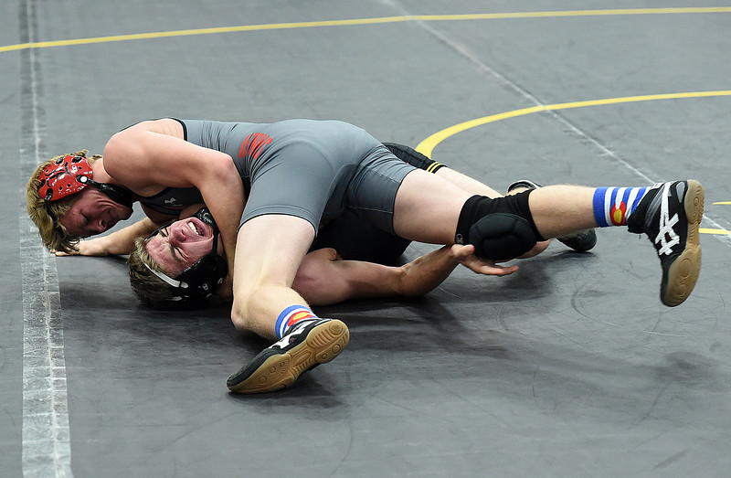 Thompson Valley's Chase Englehardt wrestles Loveland's John Hanna during their 160-pound match Friday, Dec. 9, 2016, at Thompson Valley High School in Loveland. Englehardt won the match.  (Photo by Jenny Sparks/Loveland Repdorter-Herald)